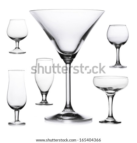 Collage of empty glasses isolated on white - stock photo