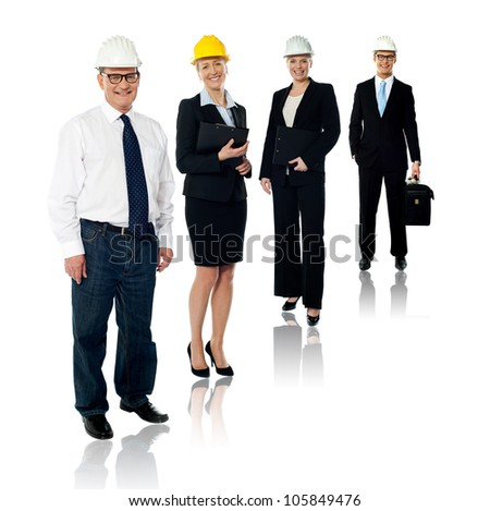 Collage of experienced architects team wearing safety helmets. Full length shot - stock photo