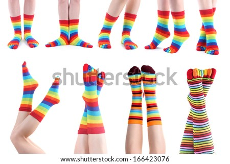 Collage of female legs in colorful socks - stock photo