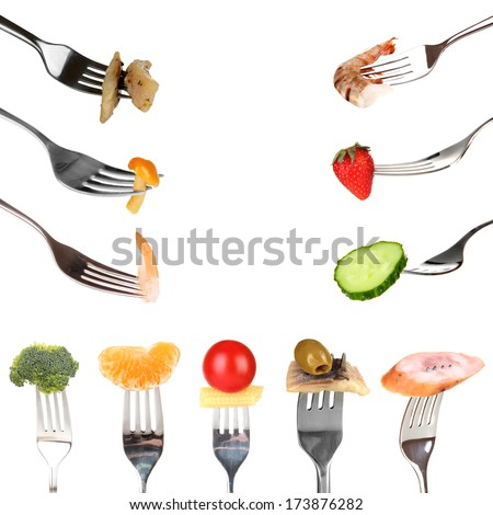 Collage of food on forks isolated on white - stock photo