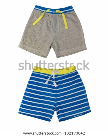Collage of male kid clothing. Boy clothes isolated on white.Shorts. - stock photo