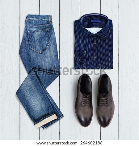 collage of modern men's clothing on a white wooden background - stock photo