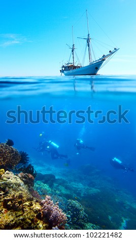 Collage of scuba divers exploring a coral reef and anchored sail boat on a surface - stock photo