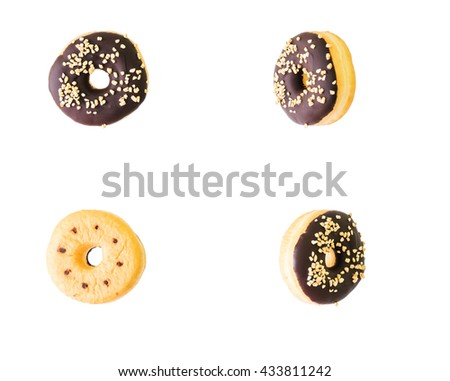 Collage of tasty donuts from different poin of views isolated on white background - stock photo