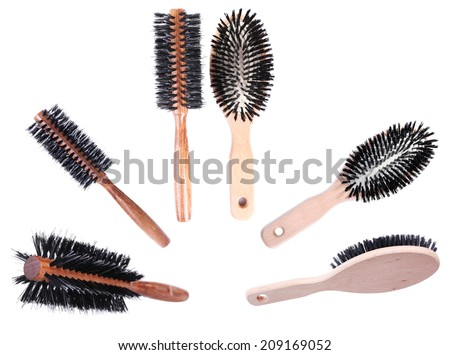Collage of wooden hairbrushes isolated on white - stock photo