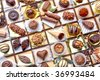 Collage with different chocolates and truffle, arranged by myself - stock photo
