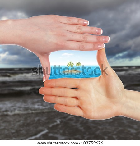 Collage with human hands and tropical island against blue sky - stock photo