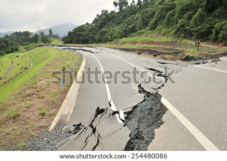 Collapsed Asphalt Road Cracked and Broken. - stock photo