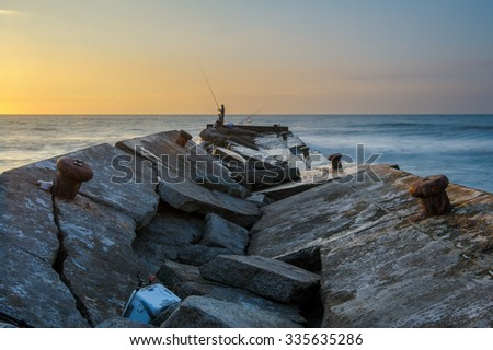 collapsed jetty to the sea