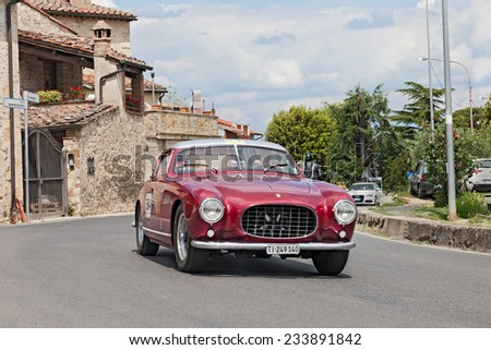 COLLE DI VAL D'ELSA, SI, ITALY - MAY 17: D. Parmegiani M. Bonzi on a vintage car Ferrari 250 GT Europa Pinin Farina (1955) in race Mille Miglia, on May 17, 2014 in Colle di Val d'Elsa, Tuscany, Italy  - stock photo
