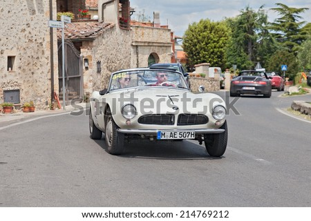 COLLE DI VAL D'ELSA, SI, ITALY - MAY 17: the crew Wortmann - Dralle on a vintage BMW 507 Touring Sport (1957) in historical race Mille Miglia, on May 17, 2014 in Colle di Val d'Elsa, Tuscany, Italy
