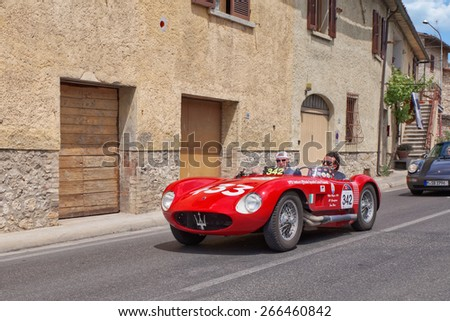 COLLE VAL D'ELSA, SI, ITALY - MAY 17: drivers P.Berton M. Peruzzi on Maserati 150 S (1955) travels in Tuscany during the classic car race Mille Miglia, on May 17, 2014 in Colle Val d'Elsa, SI, Italy  - stock photo