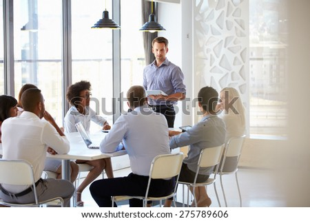 Colleagues at an office meeting - stock photo