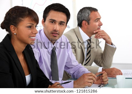 colleagues at meeting - stock photo