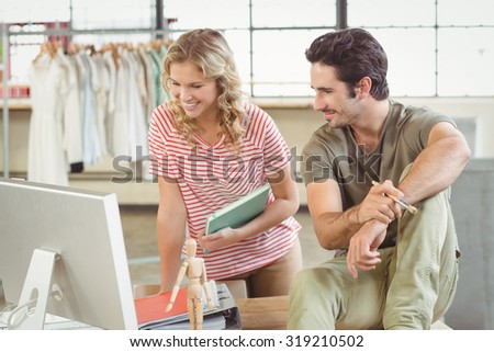 Colleagues discussing in creative office - stock photo