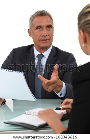 Colleagues exchanging ideas - stock photo