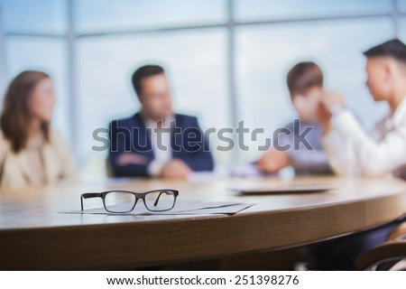 colleagues meeting to discuss their future financial plans only silhouettes being viewed - stock photo
