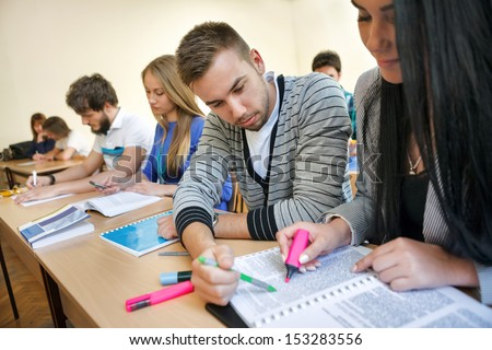 colleagues students on class working together - stock photo