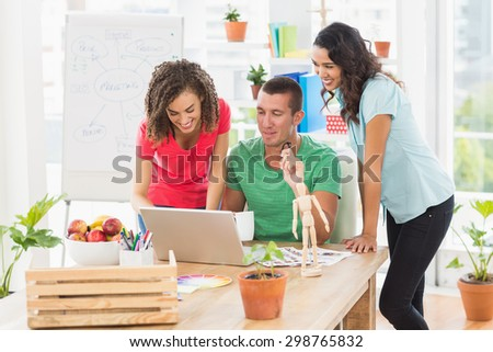 Colleagues using a computer at the office - stock photo