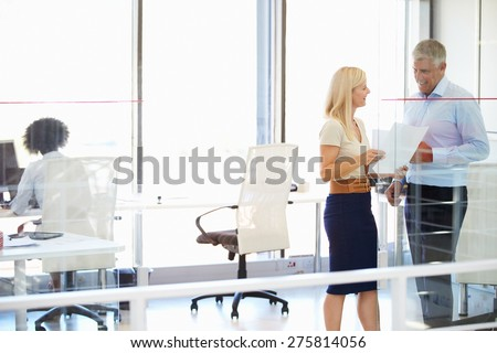 Colleagues working in a modern office - stock photo