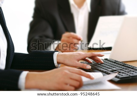 Colleagues working together in office - stock photo