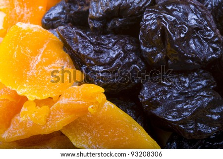 Collected different kinds of dried fruits: prunes, and mango