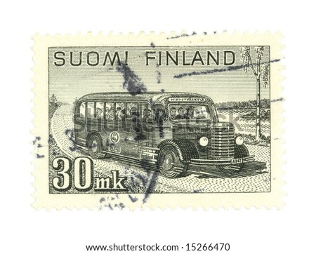 Collectible stamp from Finland. One with a vintage school bus. - stock photo