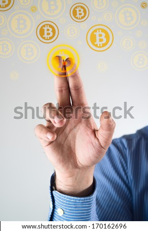 Collecting bitcoins, businessman pressing bitcoin icon. Conceptual image. - stock photo