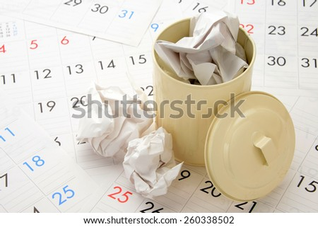 Collection day schedule images, paper trash and trash can on calendar - stock photo