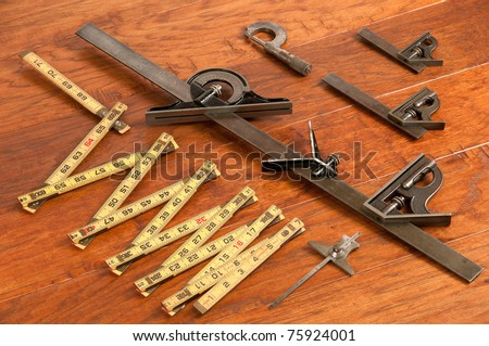 Collection of antique measurement  tools, background fruit wood toned. - stock photo