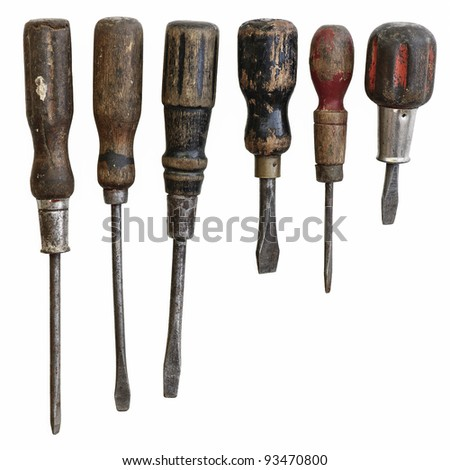 Collection of antique well used screwdrivers on a white background.