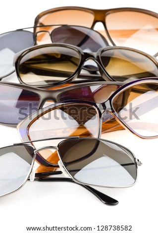 Collection of assorted styles of tinted sunglasses on white background - stock photo