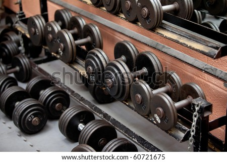 Collection of barbells lying in a sports center - stock photo