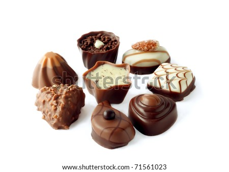 collection of beautiful delicious chocolate candies isolated on white background - stock photo