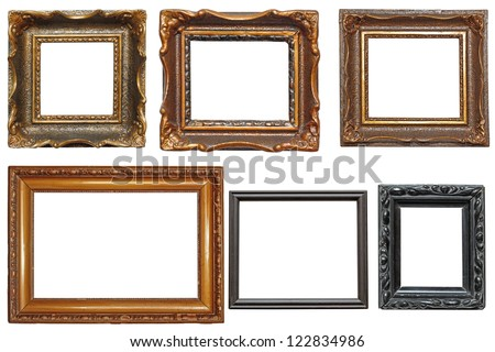 collection of beautiful old wooden frames for paintings isolated on white background - stock photo