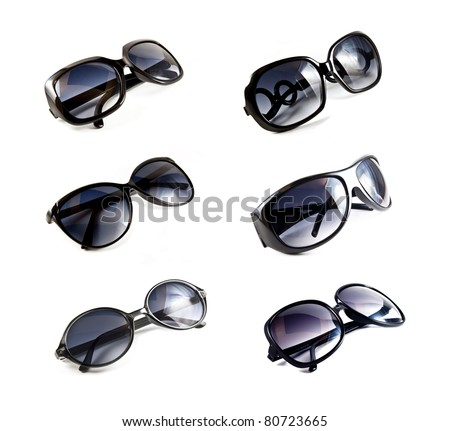 collection of black sunglasses isolated on white background - stock photo