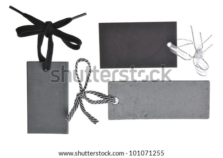 collection of blank black cardboard paper labels isolated on the white background