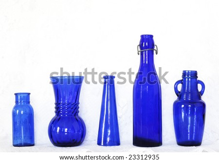 collection of blue glass bottles
