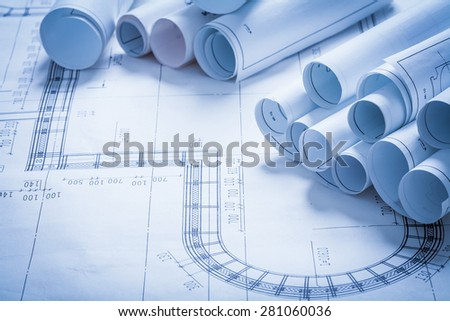 Collection of blueprint rolls construction concept - stock photo