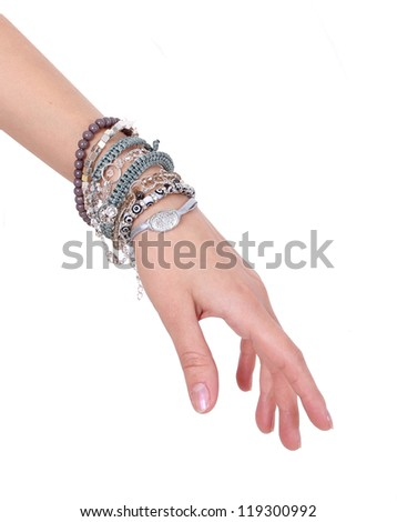 collection of bracelets on woman hand isolated on  white background - stock photo