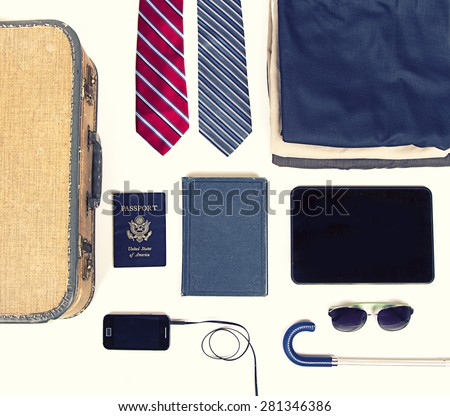 collection of business travel items with a vintage filter  - stock photo