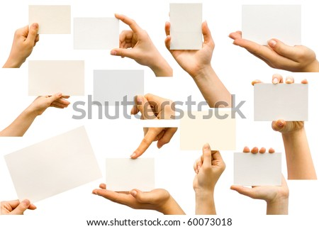 Collection of card blanks in a hand on white background - stock photo