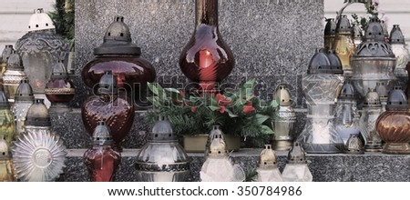 Collection of Catholic Church Votive Candle Lanterns Remembering the Dead - stock photo