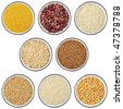 Collection of cereals and legumes in bowls isolated on white background. Top view - stock photo