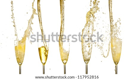 Collection of champagne wine glasses splashing out - stock photo