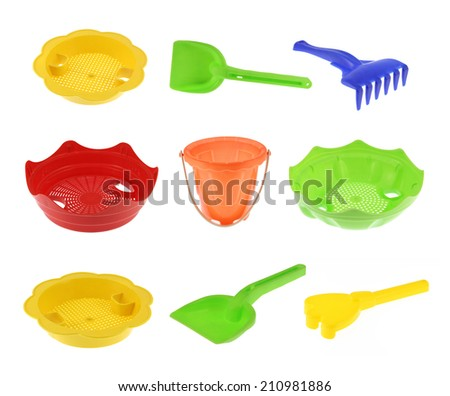 Collection of children's beach toys, buckets, spade and shovel for sandboxes isolated on white  - stock photo
