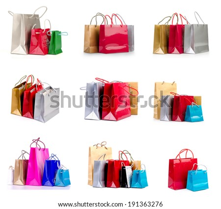 collection of colored shopping bags on a white background. - stock photo