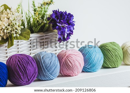 Collection of colorful balls of woolen yarn on the shelf - stock photo