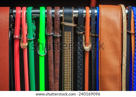 Collection of Colorful  Belts on Rack  - stock photo