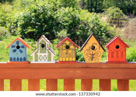 Collection of colorful wooden birdhouses. - stock photo